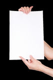Woman hands holding blank paper sheet Stock Image