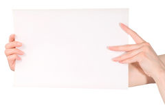 Woman hands holding blank white paper sheet Stock Photo
