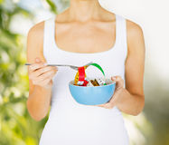 Woman hands holding bowl with measuring tape Stock Photography