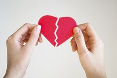 Woman hands holding a broken heart shape. stock photos