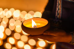 Woman hands holding candle cup royalty free stock photography