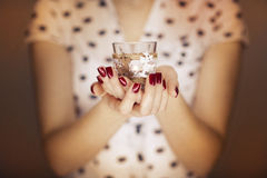 Woman hands holding a candle light Stock Photos