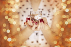 Woman hands holding a candle light Royalty Free Stock Images