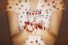 Woman hands holding a candle light Royalty Free Stock Image