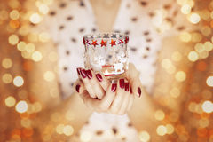 Woman hands holding a candle light Royalty Free Stock Photos