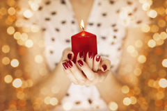 Woman hands holding a candle light Stock Images