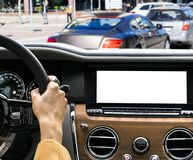 Woman hands holding car steering wheel of a modern car. Hands on steering wheel of a car driving. Girl driving a car inside cabin. royalty free stock photography