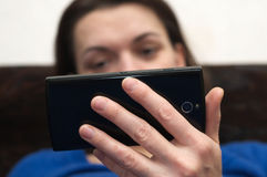 Woman hands holding cell phone. Focus on hands stock photo