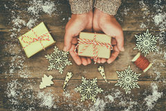 Woman hands holding Christmas presents royalty free stock photography