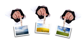 Woman hands holding clip thru wall hole Royalty Free Stock Photography