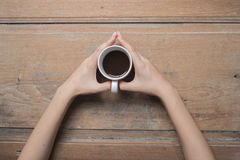 Woman hands holding coffee cup Stock Image