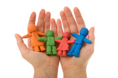 Woman Hands Holding Colorful Clay People Family Stock Images