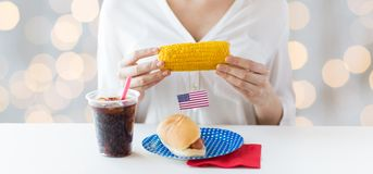 Woman hands holding corn with hot dog and cola Royalty Free Stock Photo