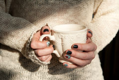 Woman hands holding cup of coffee Royalty Free Stock Photos