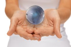 Woman hands holding earth globe Stock Image