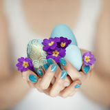 Woman hands holding easter egg Royalty Free Stock Image