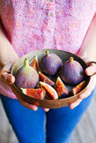 Woman hands holding figs Royalty Free Stock Photos