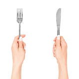 Woman hands holding a fork and a knife Royalty Free Stock Images