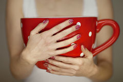 Woman hands holding giant coffee cup Royalty Free Stock Photography