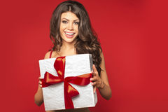 Woman hands holding gift Royalty Free Stock Photos