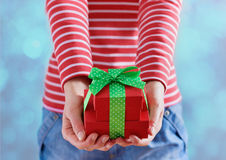 Woman hands holding a gift or present box with bow of green ribbon for Valentines Day Stock Photos