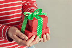 Woman hands holding a gift or present box with bow of green ribbon. Stock Photography