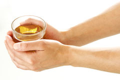 Woman hands holding a glass of tea Stock Photography