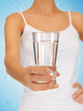 Woman hands holding glass of water Royalty Free Stock Images