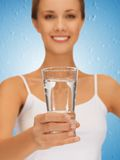 Woman hands holding glass of water Royalty Free Stock Image