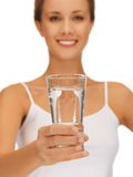 Woman hands holding glass of water Stock Photography