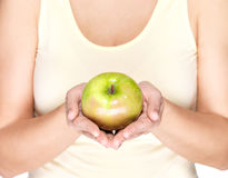 Woman hands holding green apple Royalty Free Stock Photo
