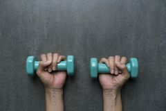 Woman hands holding green dumbbells Royalty Free Stock Photo