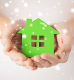 Woman hands holding green house Royalty Free Stock Image