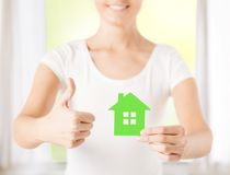 Woman hands holding green house Royalty Free Stock Photography