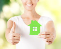 Woman hands holding green house Royalty Free Stock Photos