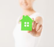 Woman hands holding green house Stock Image