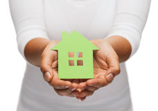 Woman hands holding green house Stock Photo