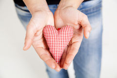 Woman hands holding a heart Royalty Free Stock Images