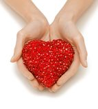 Woman hands holding heart Royalty Free Stock Photos