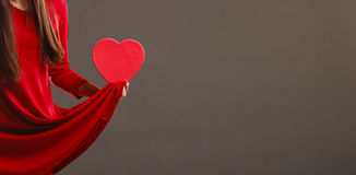Woman hands holding heart shaped box Royalty Free Stock Photography