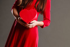 Woman hands holding heart shaped box Stock Images