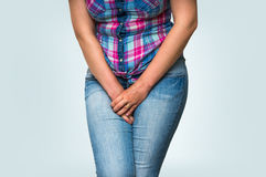 Woman with hands holding her crotch, she wants to pee. Urinary incontinence concept Stock Image