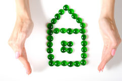 Woman hands holding little house icon Royalty Free Stock Photography
