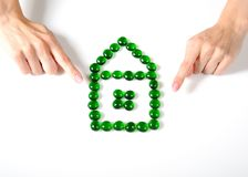 Woman hands holding little house icon Royalty Free Stock Image