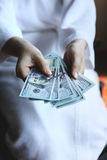 Woman hands holding money Stock Photos