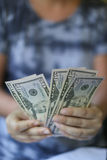Woman hands holding money. Fan Stock Photography