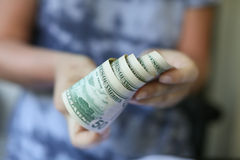 Woman hands holding money. On a neutral background Stock Photography