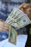 Woman hands holding money. On a neutral background Stock Photos
