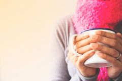 Woman hands holding a mug of coffee or tea, Toned picture. With copy space stock photos