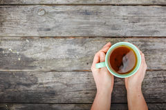 Woman hands holding mug of hot drink Stock Photography